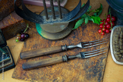Still-life from vintage objects. Old forks close-up Plakat
