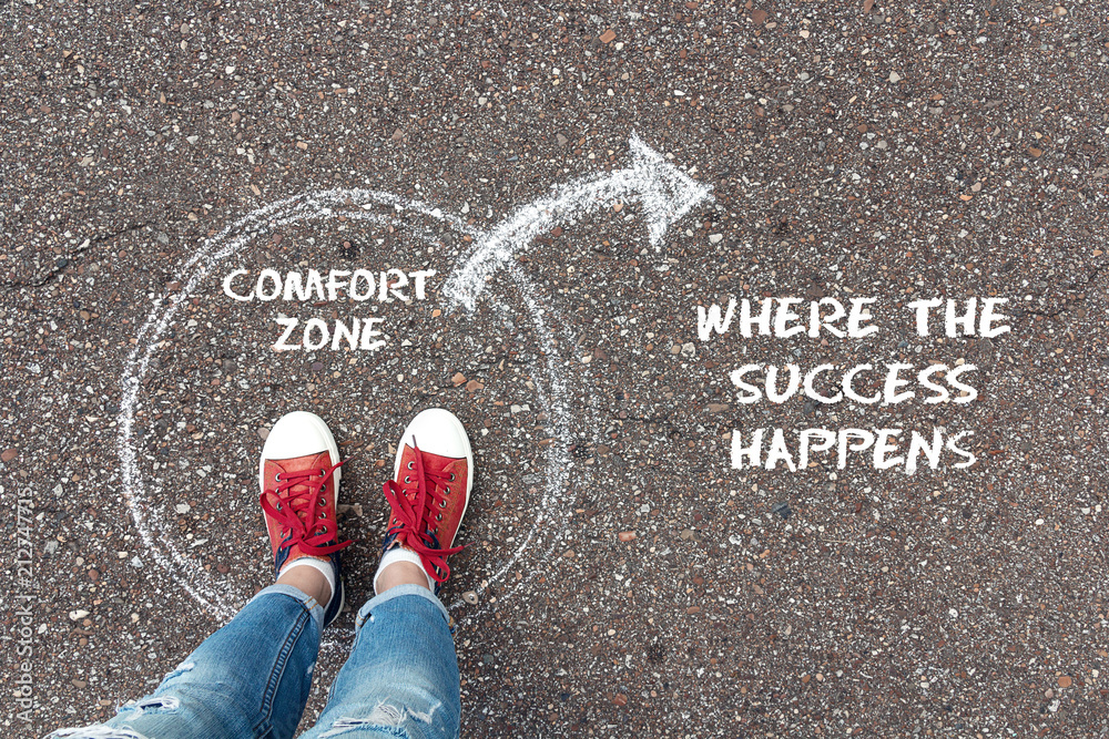Fototapety, obrazy: Exit from the comfort zone concept. Feet  standing inside circle comfort zone and outward arrow chalky on the asphalt.