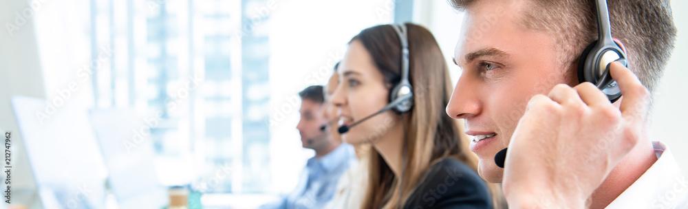Fototapeta Male operator staff with team working call center