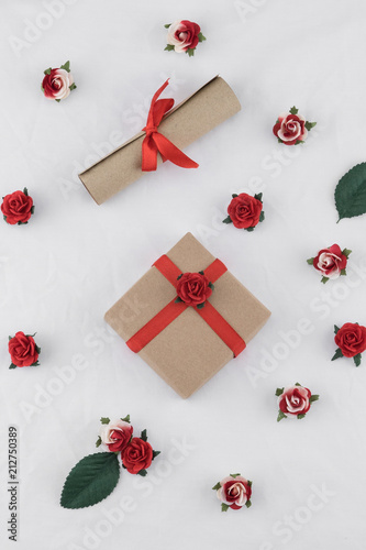 Brown Gift Box And Scroll Decorate With Red Rose Paper Flowers On