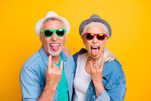 My Parents Are Crazy! Music Lovers Rock Fans Concept Youth Concept. Close Up Photo Portrait Of Excited Funky Funny Comic Cheerful Guy And Lady Making Stick Tongue Out Sign Isolated Bright Background