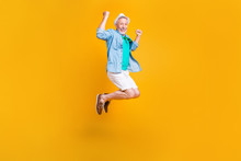 Freedom Fly Happiness Hipster White Jeans Shorts Stylish Modern Green Outfit Concept. Full Length Size Photo Portrait Of Joyful Rejoicing Handsome Laughing Cheerful Guy Jumping Up Isolated Background