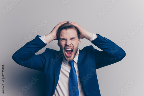 Portrait of violent, stylish, attractive, angry man in blue suit, tie with brist Canvas-taulu