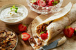 canvas print picture - Fresh ingredients for preparing a strawberry wrap