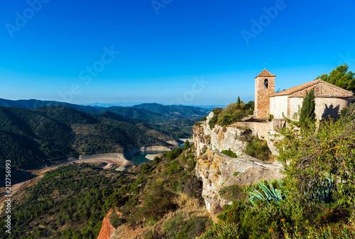 Foto op Plexiglas Cyprus View of the romanesque church of Santa Maria de Siurana, in Siurana, Tarragona, Spain. Copy space for text.