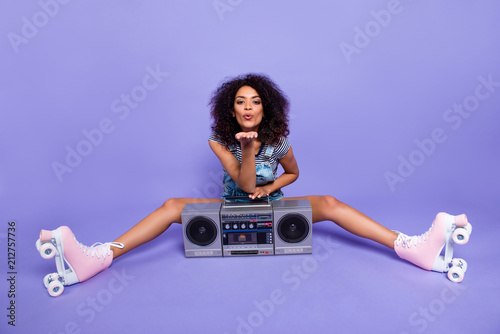 Canvas Prints Palm tree Portrait of lovely flirting girl wearing roller skates having boom box blowing air kiss with pout lips palm at camera isolated on vivid violent background retro vintage quad student concept