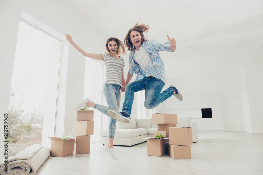 Fototapety, obrazy: Yes yeah hooray wow! Change improvement success good mood day emotion expressing ownership concept. Full length size photo portrait of joyful cheerful partners jumping up holding hands