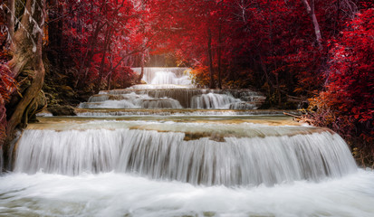 Fototapetawaterfall landscape in autumn forest