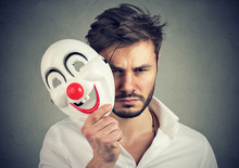 Unhappy Man Covering Feelings With Mask