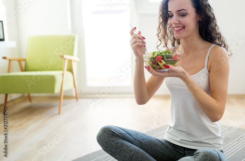 Fototapeta Fitness woman eating healthy food after workout obraz