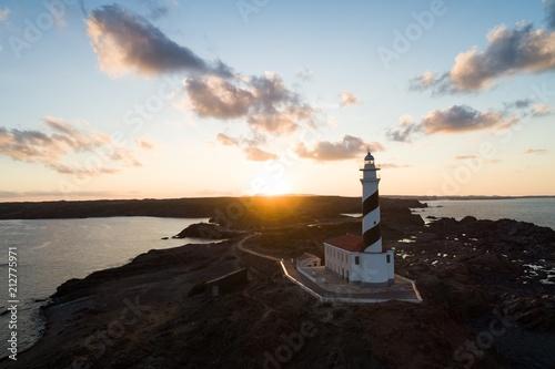 Foto op Aluminium Vuurtoren Lighthouse during sunset