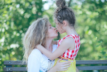Daughter Kisses Mom / Happy Family Mom And Daughter Kiss, Concept Of Female Happiness, Beautiful Mother And Daughter 5 Year Old Kiss