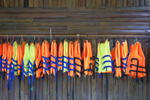 Row Of  Life Jacket Hanging Fo...