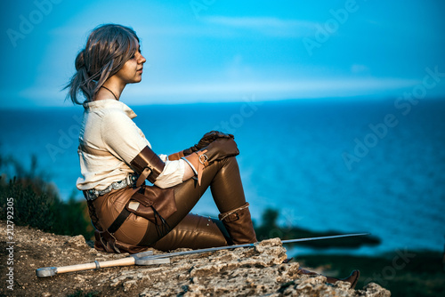 Photo  Fantasy cosplay beautiful Witcher girl on cliff
