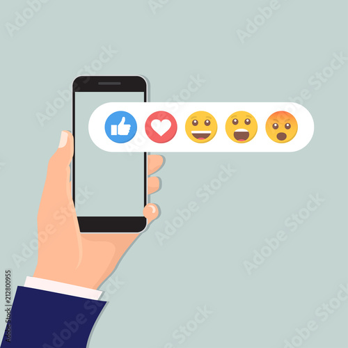 Fotografía  Hand holding smartphone with social network feedback emoticons