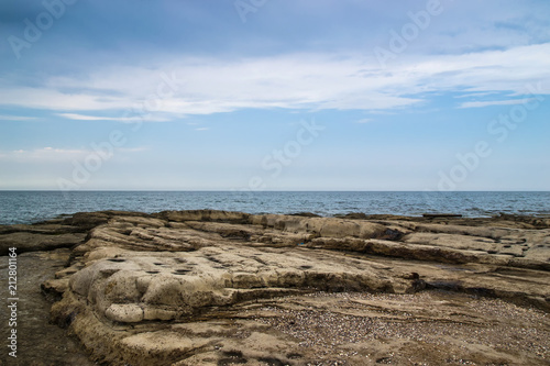Foto op Aluminium Kust Quite a picturesque view of the rocky coastline of the Black Sea by cloudy day