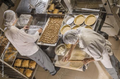 Spoed Fotobehang Bakkerij Cookie Bakery Two bakers preparing delicious treats
