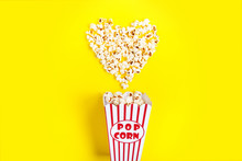 I Like Watching Films. Spilled Popcorn In The Shape Of Heart And Paper Bucket In A Red Strip On Blue Background.