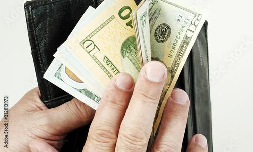 purse with money in the hands of men, spending money Tapéta, Fotótapéta