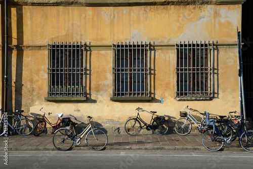 Staande foto Fiets Bikes by old building