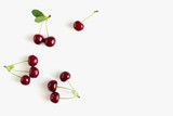 Cherry pattern. Ripe cherry berries and leaves isolated on white background. Berry summer background. Flat lay, top view, copy space