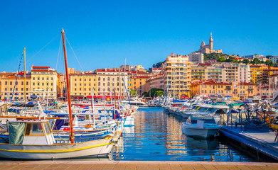Summer view on basilica of Notre Dame de la Garde and old port in Marseille, France