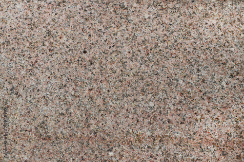 Tuinposter Stenen Marble texture. The background is a palyned plate. A product made of stone. Fragments of small stones. Smooth surface with a glossy sheen reflecting light. Soft warm honeyed tone. Orange color.