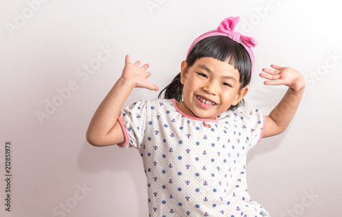 Valokuvatapetti Portrait of child acting very happy