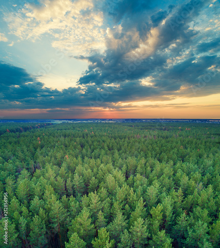Foto op Aluminium Luchtfoto Aerial drone view of countryside, rural landscape with beautiful cloudy sky at sunset
