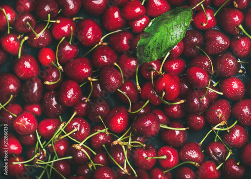 Fresh sweet cherry texture, wallpaper and background. Flat-lay of wet sweet cherries, top view. Summer food or local market produce concept