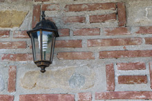 Exterior Light Fixture Mounted On Brick Wall With Copy Space. Energy Saving Light Bulb Installed.