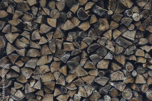 Dried chopped stacked firewood logs