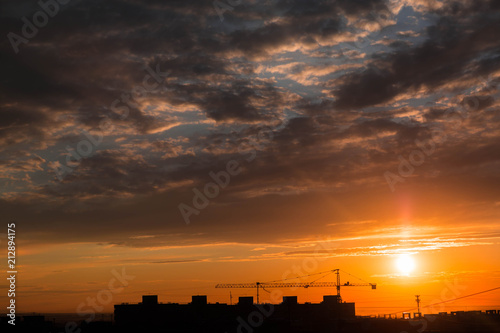 Foto op Canvas Candy roze Construction crane on sunset background