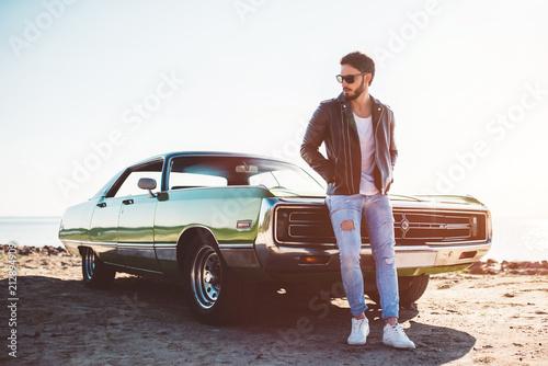 Man with retro car