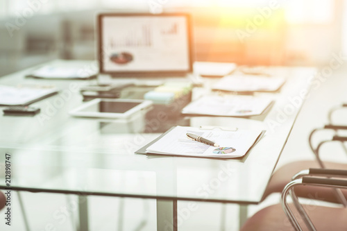 Obraz  workplace with laptop and working documents for the business team in a modern office - fototapety do salonu