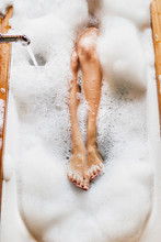Woman Legs In Bath Foam. Top V...