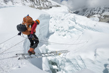 Mountaineer Crossing Icefall On Ladder