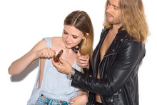 Young Addicted Couple With Pipe Smoking Marijuana On White