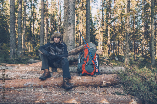 Sweden, Sodermanland, backpacker resting in remote landscape