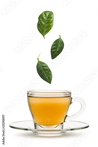 tea leaves falling into tea cup, on white background