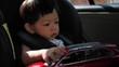 cute baby playing toy in car seat safe drive of road trips travel