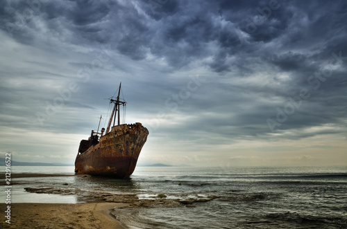 Fotobehang Schipbreuk Dimitrios is an old ship wrecked on the Greek coast and abandoned on the beach