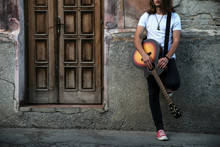 Young Man Holding Acoustic Guitar