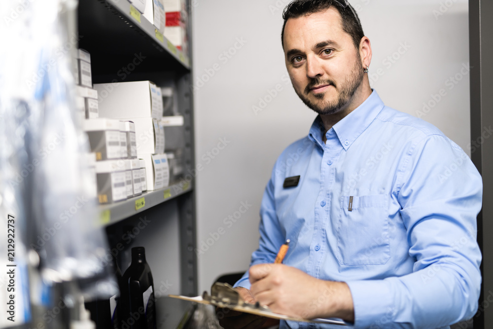 Fototapeta merchandiser checking products availibility for car repair