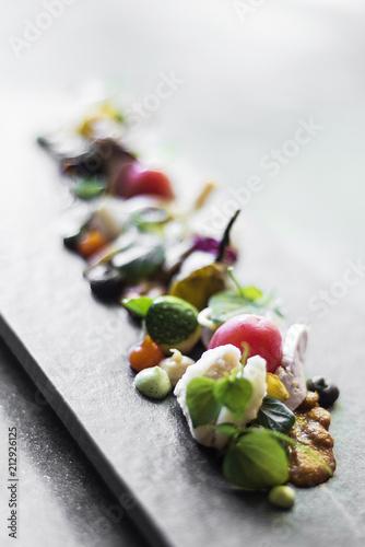 Fototapeta modern gourmet creative cuisine salad with goat cheese and figs obraz