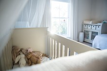 Wooden Cradle With Soft Toys At Home