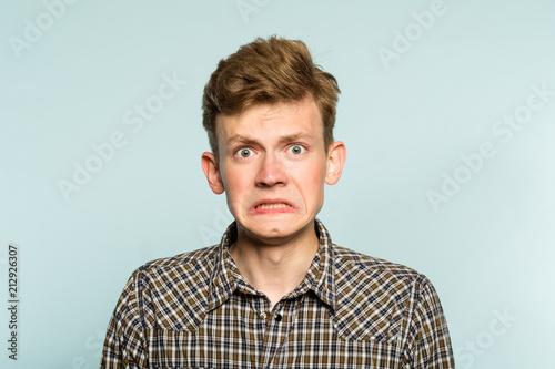 Fotografie, Tablou  awkward gawky fumbling oafish dorky man facial expression