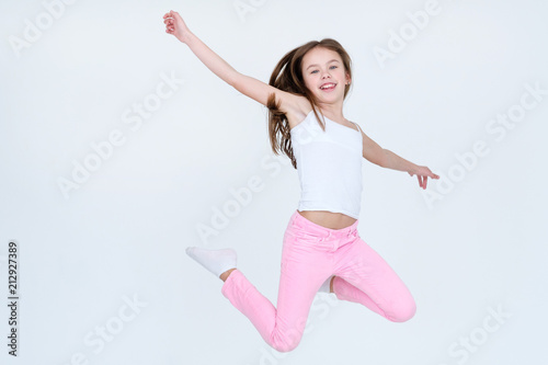 2c599e97a child jumping high in the air. aireness lightness freedom happiness ...