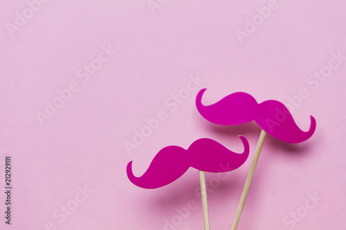 Photo Pink moustache on a pink background. Modern masculinity concept
