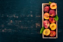 Fresh Peaches. On A Wooden Bac...